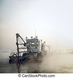 dredge boat in the fog -  dredge boat in the fog in winter