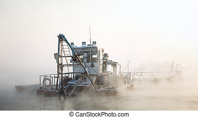 dredge boat in the fog in winter