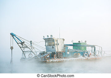 funny boat in the fog - dredge boat in the fog in winter