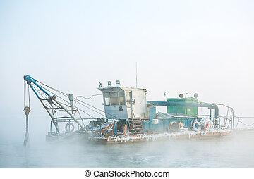 funny boat in the fog -  dredge boat in the fog in winter