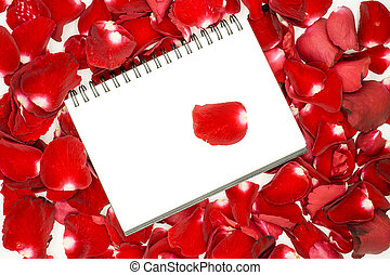 Notebook on red rose petals background