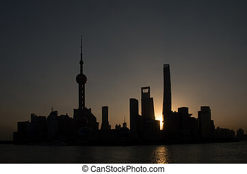 Shanghais Pudong skyline, silhouetted at sunrise