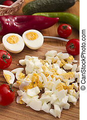 Kitchen board with finely chopped eggs, used as an...