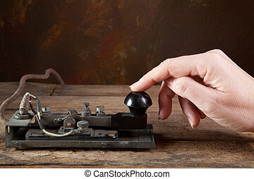 Antique telegraph - Hand tapping morse code on an antique...