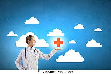 Medicine cross symbol - Attractive female doctor in white...