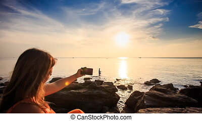 Blond Girl Makes Selfie Camera Moves to Sun Path at Sunset -...