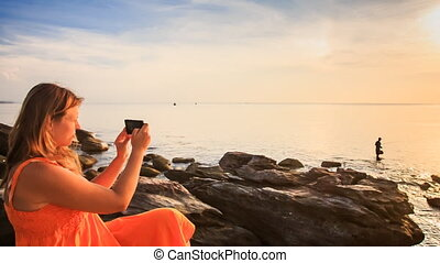 Blond Girl in Red Sits on Sea Stones Photos by Iphone at...
