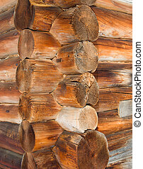 Old wooden house .Log cabin background ,The side of a log...