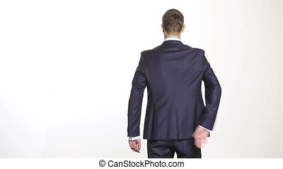 body language. man in business suit isolated white background. Training managers. sales agents. hands behind his back. grasping the forearm. gesture of self-control and anger