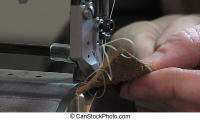 Trunk Maker at work in his workshop - ornamental stitching...