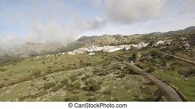4K Aerial, Flight over andalusian village, surrounded by...