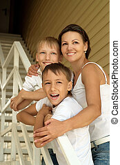 mother with her sons on stairs