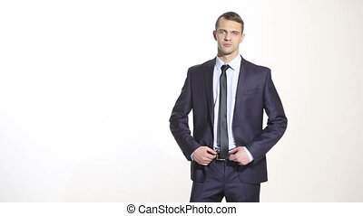 body language. man in business suit. isolated white background. hand on the belt