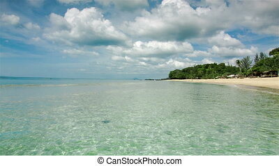 Thailand island beach with clear waves