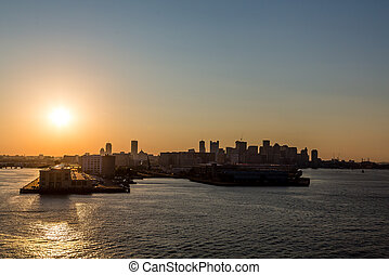 Sunset Over Boston - Skyline of Boston from the sea at...
