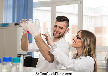 Young People Couple In Bright Modern Lab