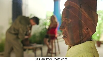 9-Closeup Wooden Statue Sculptor And Model Working In...