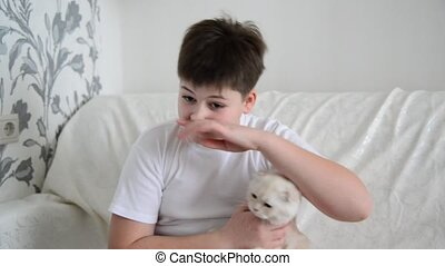 Teenager with an allergy to cats scratching nose - Teenager...