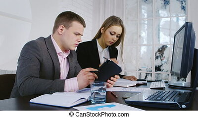 Businessman and business woman working in the office - Man...