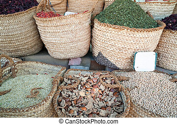 Cooking spices in baskets on sale in a city market at orient...