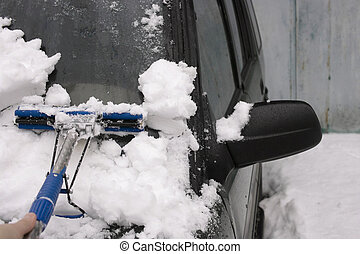 Car Under Snow - Car under snow and hand with scrapper...