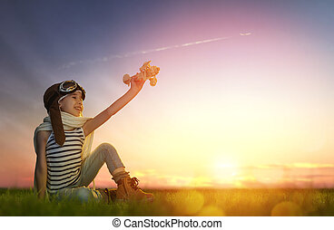 child playing with toy airplane - dreams of flight! child...