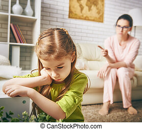 mother scolds her child - the education of the child. mother...