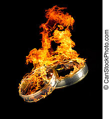 burning wedding rings - two burning wedding rings in black...