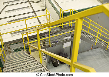 yellow stairs - yellow emergancy exit staircase in a factory