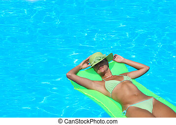 Beautiful young woman at a pool - Beautiful young woman...