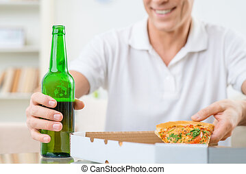 Adult man eating pizza - Enjoy your food Close up of glass...
