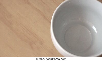 black coffee poured into cup - Looking down on a white cup...
