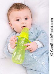 Infant boy holding his bottle - Baby with bottle Little baby...