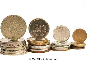 Coins of different currency on white background