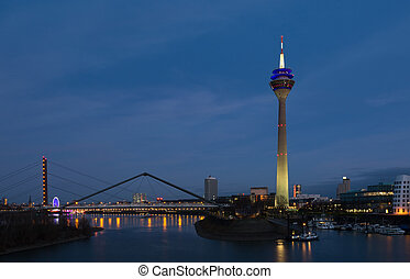 Media harbor with Rheinturm tower at night in Dusseldorf,...