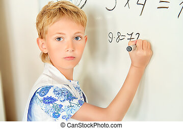 multiplication table - Schoolboy performs the tasks at the...