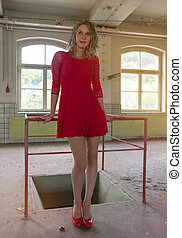 attractive woman in an old factory