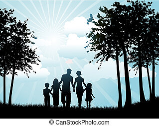 family walking - Silhouette of a family out walking on a...