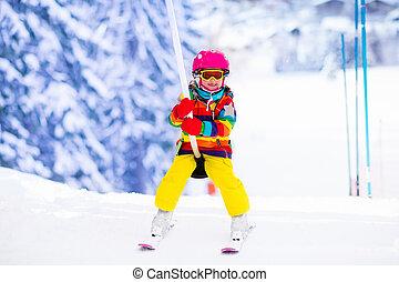 Child on ski lift - Child on a button ski lift going uphill...