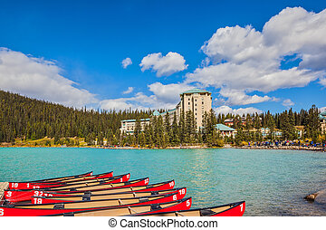 At the pier moored red canoe for tourists - Lake Louise on a...