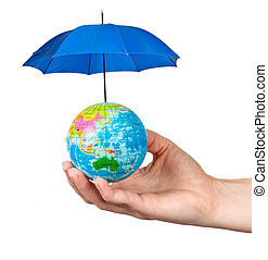 small globe in a female hand protected by an umbrella...