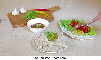 Meat dumplings served on white plate with fennel