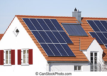 House with regenerative energy system - House roof with...