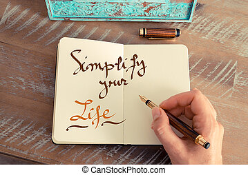 Handwritten text SIMPLIFY YOUR LIFE - Retro effect and toned...