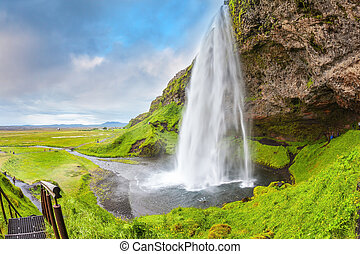 Seljalandsfoss waterfall in warm July day - Seljalandsfoss...