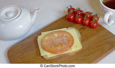 Making sandwich with tomato, ham, cheese - Man making...