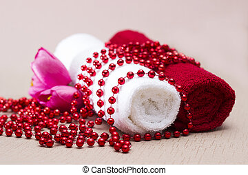 White and red towel around beads and flowers - gift box and...