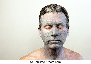 Man Wearing a Clay Mask