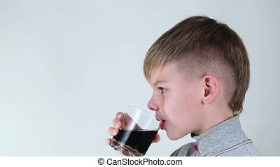 Boy drinking a carbonated beverage