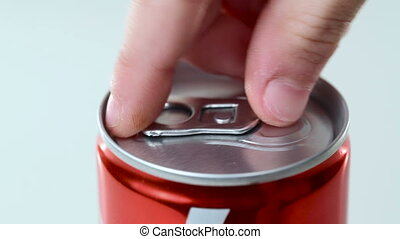 Open a can of fizzy drink White background Close-up